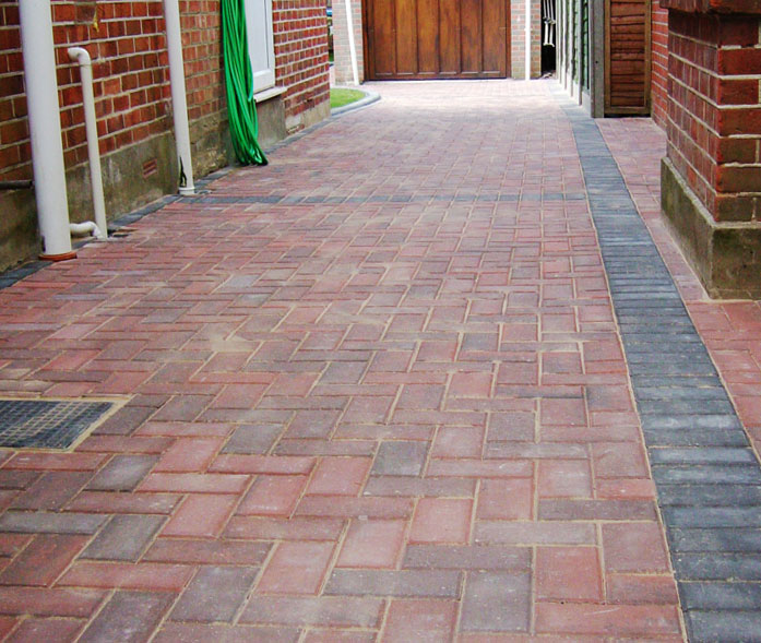 'Brindle' block paving with 'Charcoal edging'.