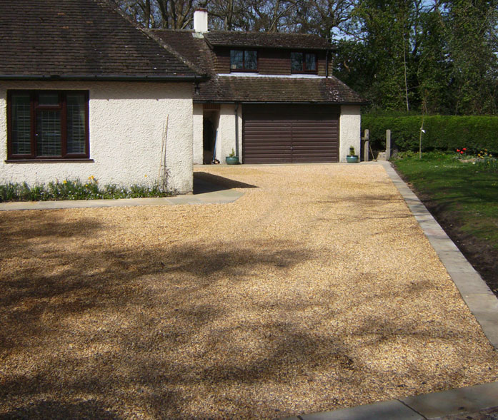 Dorset shingle driveway with honeycomb reinforcing grids to give hard surface. Limestone edging.