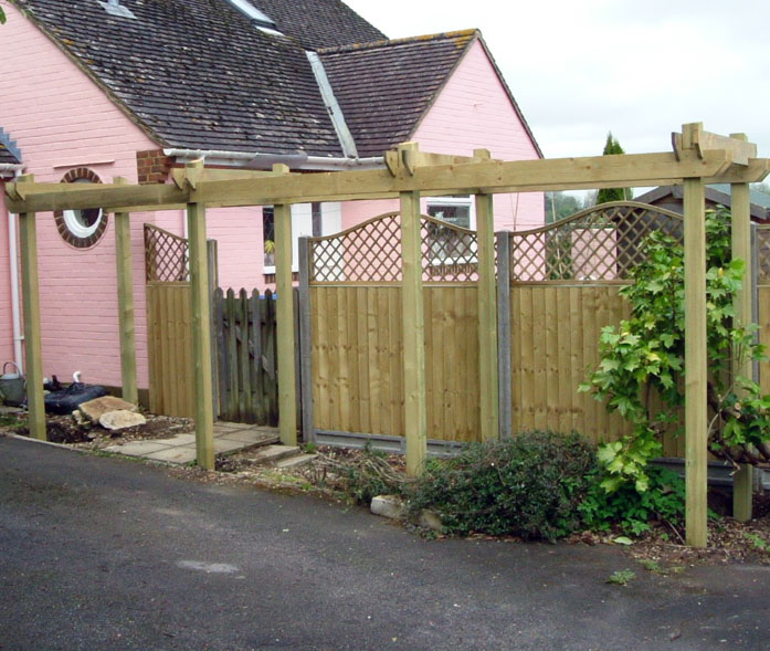 Concrete posts with close board fence panels, curved trellis and pergola.